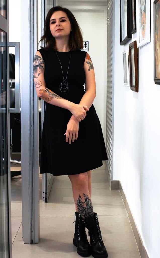 Luiza Fortes posing in her studio